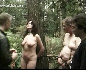 Hot slave tied to a tree with weights on her pierced pussy l
