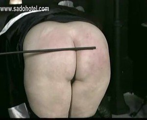 Horny nun slave is spanked on her big ass and hands by older