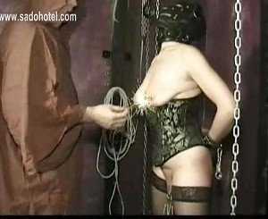 Hangin slave with big boobs gets large metal clamps on her n