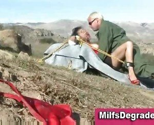 Gagged brunette in bondage fucked and jizzed outdoors