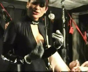 Mistress in black latex catsuit fist fucks with both hands w
