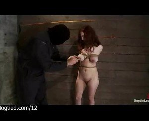 Tied busty redhead gets whipped