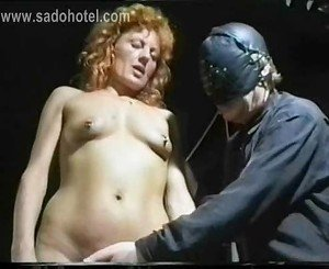 German master removes needles from slave her body and uses a