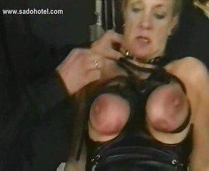 Blond slave with big tits is spanked and got her boobs tied