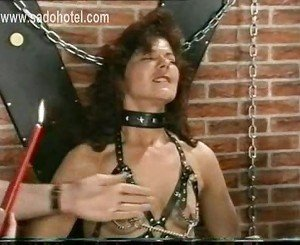 Milf slave with metal clamps on her nipples and her pussy li