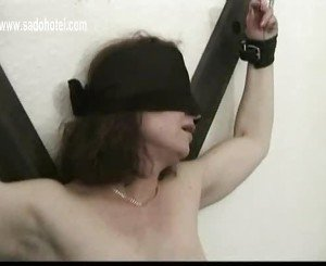 Milf slave tied to a wall gets her tight pussy finger fucked