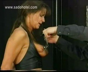 Beautiful slave got large metal clamps on her big tits and t
