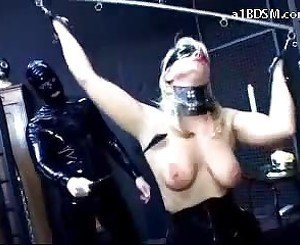 Blindfolded Girl Tied Arms Spanked In The Dungeon