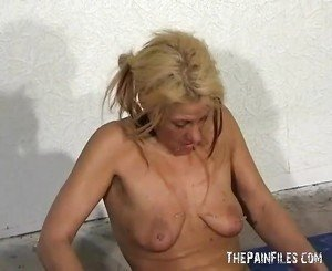 Blonde slave waxed and piercing in messy bdsm film