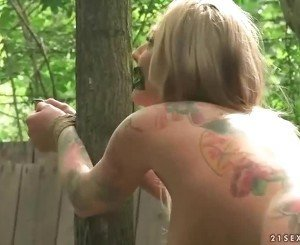 Sexy blonde gets tied up and fucked rough outdoor