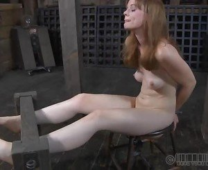 Caged hotty removes her clothings in captivity