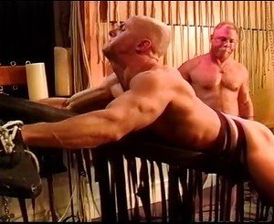 Caning my hot buddys muscle butt as hes restrained and suspended on my swinging table.