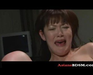 Horny Asian hottie covered in wax p1