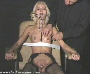 Extreme needle torture and hardcore bdsm of blonde slavegirl in severe nipple pain and tit torments tied to a bondage chair