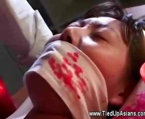 Asian youngster soaked in hot candlewax