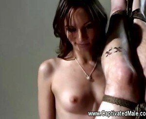 Amber Rayne showing no mercy on tattood slaves ass