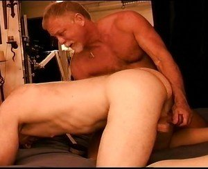 CBT 2 tops place a young hot muscular beginners ball sack in a clamp and then punish his balls.