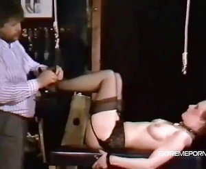 Short haired slut hung up and whipped