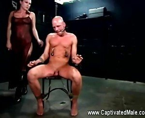 Harmony whips her nipple clammed subject and slaps his legs