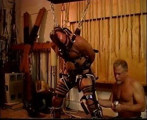 Bound and gagged like a prisoner in leather and chains I bash his balls.