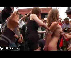 Naked babe tied up and spanked at porn fair