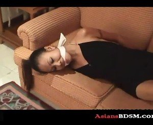 Precious Asian chick hogtied on couch