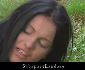Brunette beautiful submissive hogtied in the woods