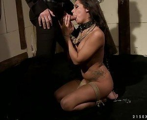 Dominated brunette gets her slippery throat hammered