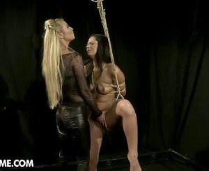 Blistering Dorina Golden torments this tied up babe
