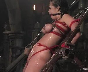 Clamped slave Mia Bangg gets some water torture