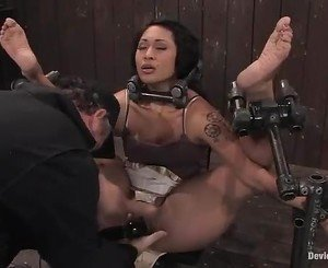 Hardore bitchy slut is bent and clamped as her throbbing clit...