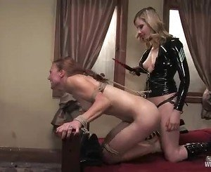 With a meat hook up her ass, a filthy slave gets a strap on s...