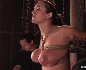Big tittied bondage whore is tied and bound and has her tits...