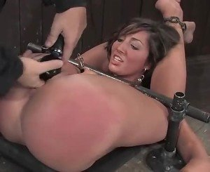 The slut was tied down as her slit was poked with fingers and...