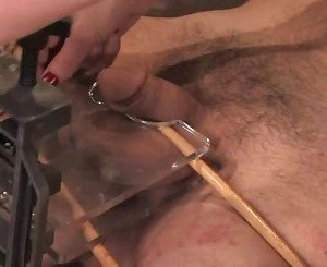 Mistress Madeline ties her slave and tortures his penis