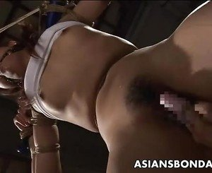 Bound Japanese gal drilled with a fat dildo