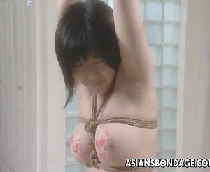 Kinky Asian slut endures a nasty bondage session